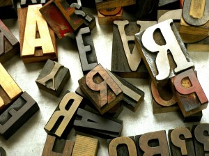 Photograph of jumbled wooden letters of the alphabet, building blocks in the encounter with foreign languages within Jewish family history research.