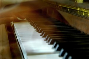 """Photograph of piano being played. Accompanying the Historytrace blogpost """"Tradition Bearers and Musical Heritage. Image copyright www.freeimages and Yaroslav B."""